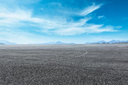 asphalt highway under the blue sky
