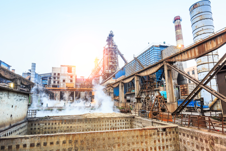 Steel plant sewage pool and industrial buildings Editorial