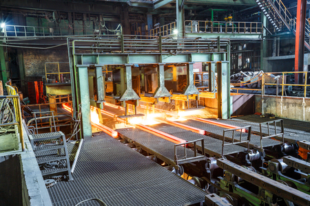 hot steel on conveyor in steel plant Editorial