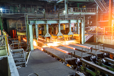 smelting plant: hot steel on conveyor in steel plant Editorial