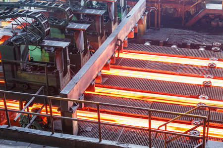 hot steel on conveyor in steel plant Stock Photo