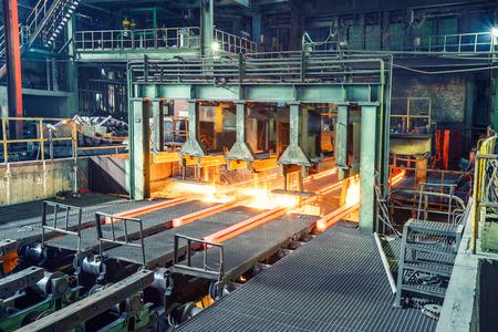 hot steel on conveyor in steel plant Editorial