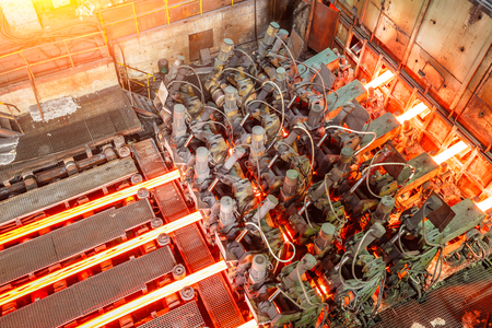 smelting plant: hot steel on conveyor in steel plant Stock Photo