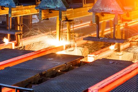 hot steel on conveyor in steel plant Zdjęcie Seryjne