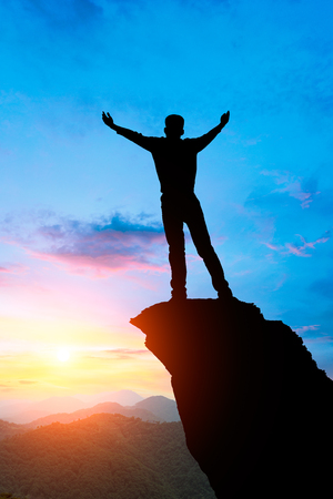 Silhouette of the man success on the peak of mountain, Sport and active life sunset landscape Stock Photo
