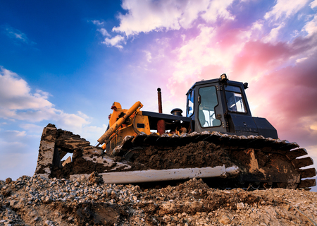 earthmover: bulldozer on a building site at sunset Stock Photo