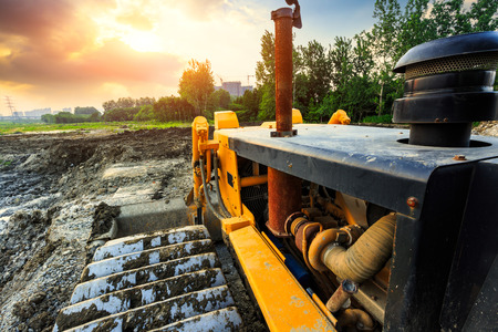 bulldozer on a building site at sunset Stock Photo
