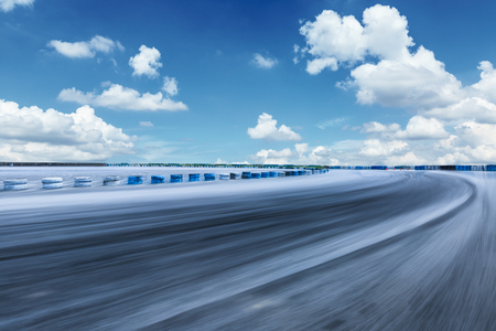 Motion blur asphalt road circuit and beautiful sky clouds