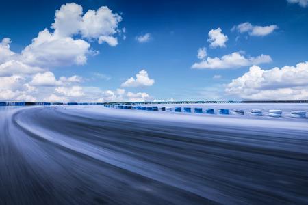 Motion blur asphalt road circuit and beautiful sky clouds
