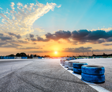 Asphalt road circuit and sky sunset with car tire brake Stock Photo