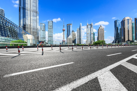 Shanghai Lujiazui financial district commercial buildings and asphalt road scenery, China
