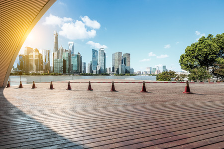 Empty city square floor and modern city commercial buildings scenery in Shanghai, China 免版税图像