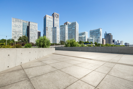 Empty city square floor and modern city commercial buildings scenery