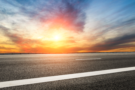 Empty highway asphalt road and beautiful sky sunset landscape 写真素材