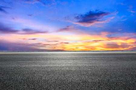 Empty highway asphalt road and beautiful sky sunset landscape Standard-Bild
