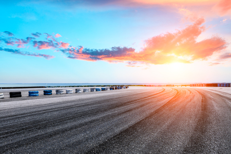 international circuit asphalt road and sky with clouds at sunset Stock Photo