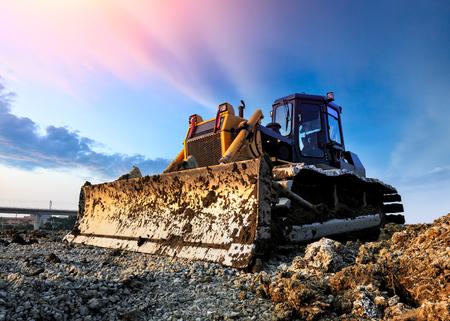 bulldozer at construction site and sunrise landscape Reklamní fotografie