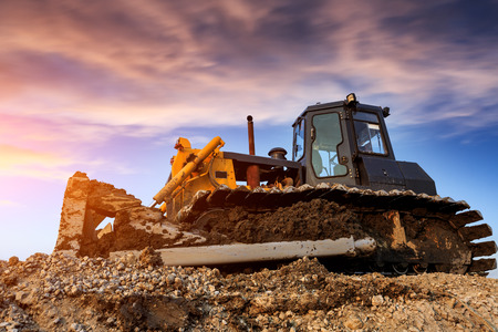 bulldozer at construction site and sunrise landscape Stock Photo