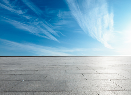 empty square floor and blue sky with white clouds in the daytime