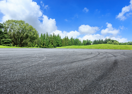 empty asphalt road ground and green forest in summer Stock Photo