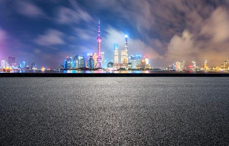 clean asphalt road with modern city skyline background,shanghai,china