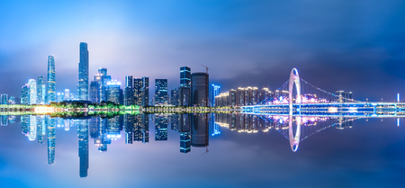 Guangzhou China modern city skyline panorama on the zhujiang river at night 스톡 콘텐츠