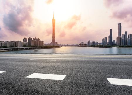 asphalt road and modern city skyline in Guangzhou at sunset,China 版權商用圖片 - 101963316