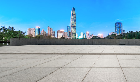 empty square floors and modern city skyline in Shenzhen at night,China