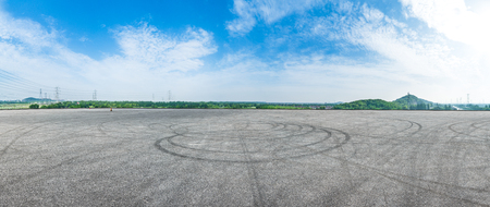 Empty asphalt square road under the blue sky,panoramic view