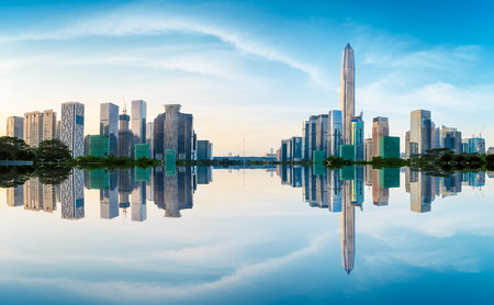 Beautiful modern city skyline and water reflection in Shenzhen at sunrise