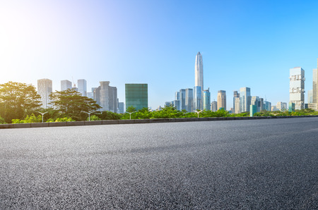 Empty asphalt road and modern city skyline panorama in Shenzhen,China Фото со стока