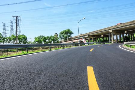 Empty asphalt highway and bridge building