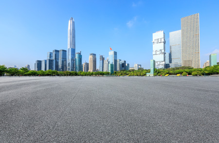 Asphalt road and modern city commercial buildings panorama in Shenzhen