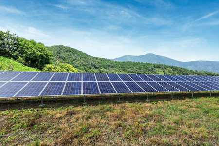 Solar panels and mountains landscape  免版税图像