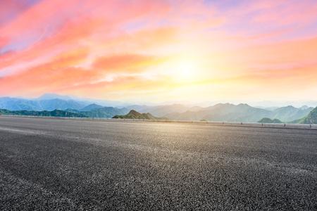 Asphalt highway and mountain natural landscape at sunrise