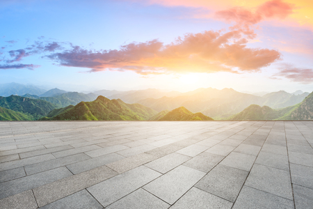 Clean square floor and mountain natural landscape at sunrise