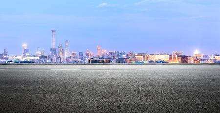 Panoramic beijing skyline and buildings with empty road Foto de archivo