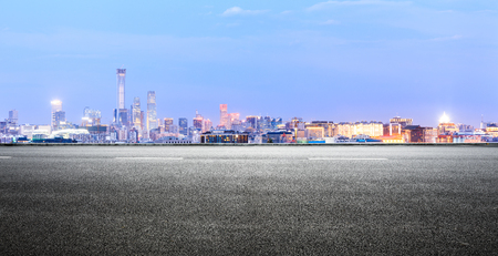 Panoramic beijing skyline and buildings with empty road Stock Photo