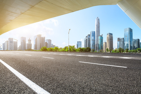 Empty asphalt road and modern city buildings in Shenzhen,China