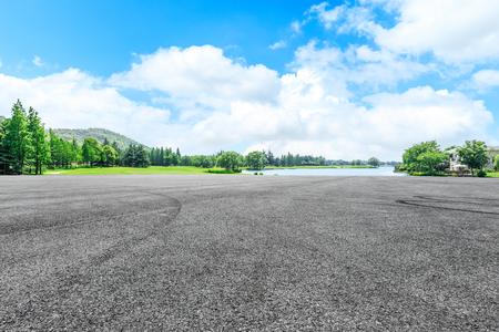Asphalt road race track and green forest natural landscape 写真素材