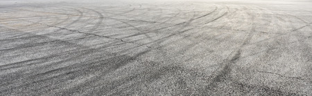 Car track asphalt pavement background at the circuit 写真素材
