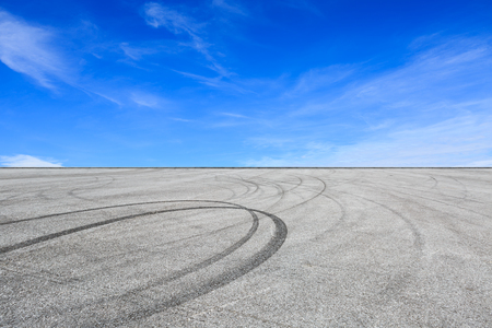 Car track square and blue sky with white clouds on a sunny day 写真素材