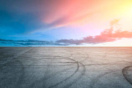 Car track square and sky scenery at sunset Banco de Imagens