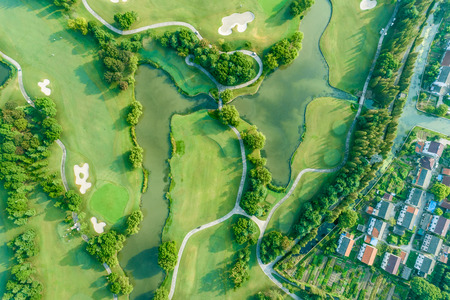 Aerial photograph of forest and golf course with village
