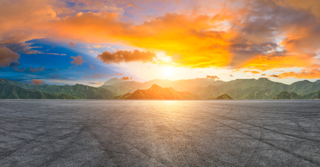 International circuit road and dramatic sky with mountain panorama at sunset Stock Photo