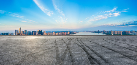 Empty asphalt road and city skyline at sunrise in hangzhou,high angle view