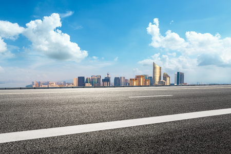 Empty asphalt road and city skyline in Hangzhou,high angle view