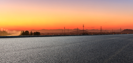 Empty asphalt road and hills at beautiful sunset,panoramic view Stock Photo