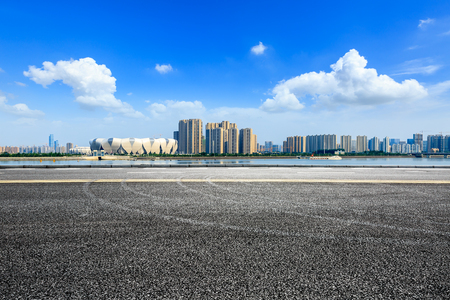 Empty asphalt road and modern city skyline with buildings in Hangzhou