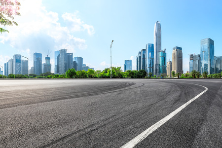 Empty asphalt square ground and city skyline with buildings in Shenzhen